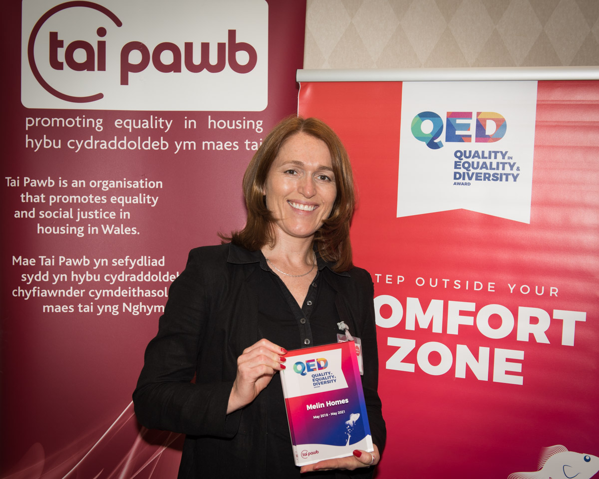 Paula Kennedy from Melin Homes holds a QED Award