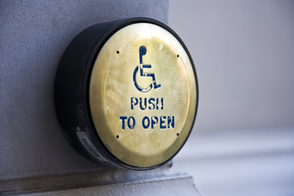 Push to open button for disabled people
